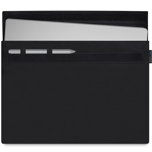 The picture shows the front of Classic Sleeve for Microsoft Surface Book 13.5 with Surface Pen Holder in color Black; As an illustration, it also shows what the compatible device looks like in this bag