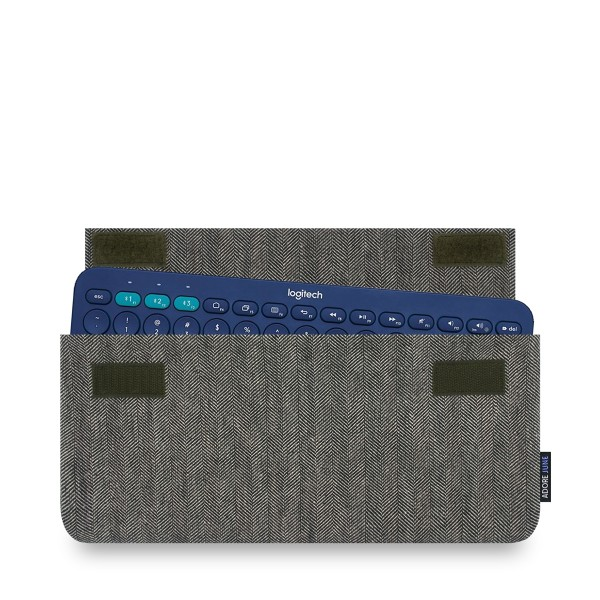 The picture shows the front of Keeb Business Sleeve for Logitech K380 Multi-Device Bluetooth Keyboard in color Grey / Black; As an illustration, it also shows what the compatible device looks like in this bag