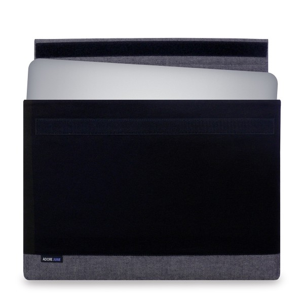 The picture shows the front of Bold Sleeve for Dell XPS 15 in color Grey / Black; As an illustration, it also shows what the compatible device looks like in this bag