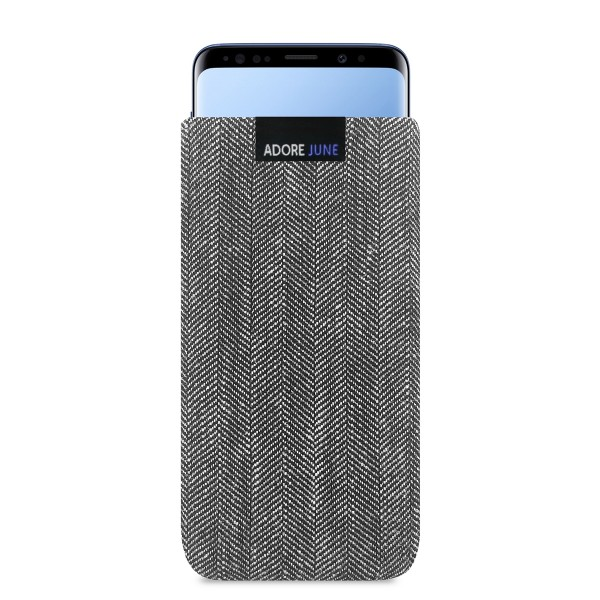 The picture shows the front of Business Sleeve for Samsung Galaxy S9 in color Grey / Black; As an illustration, it also shows what the compatible device looks like in this bag