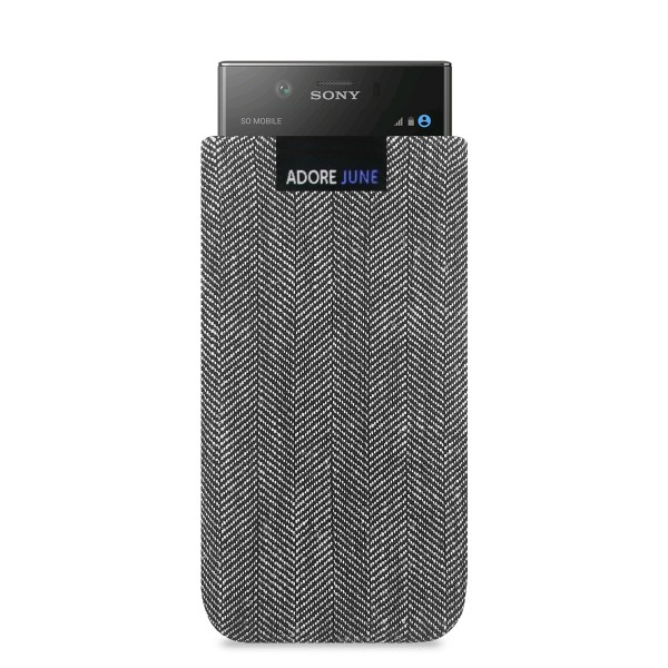The picture shows the front of Business Sleeve for Sony Xperia XZ1 Compact in color Grey / Black; As an illustration, it also shows what the compatible device looks like in this bag
