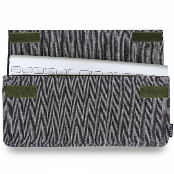 The picture shows the front of Keeb Business Sleeve for Apple Wireless Keyboard 1st Gen in color Grey / Black; As an illustration, it also shows what the compatible device looks like in this bag