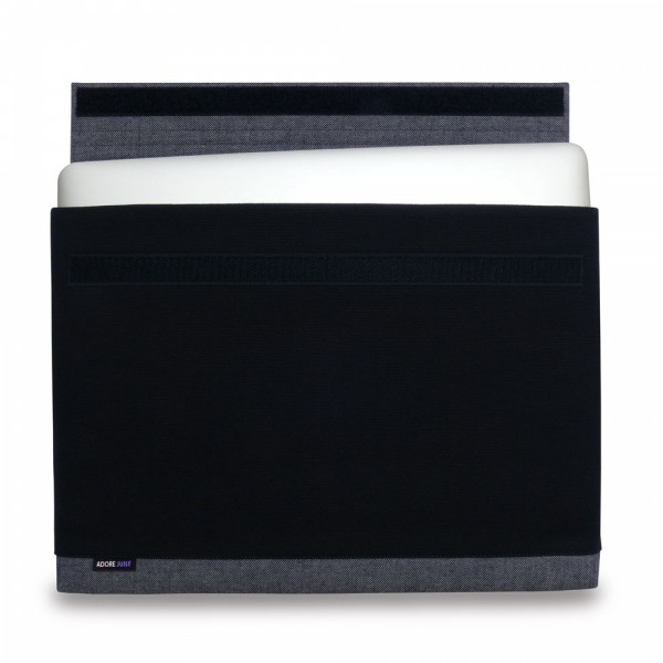 The picture shows the front of Bold Sleeve for Apple MacBook Pro 13 2012-2015 in color Grey / Black; As an illustration, it also shows what the compatible device looks like in this bag