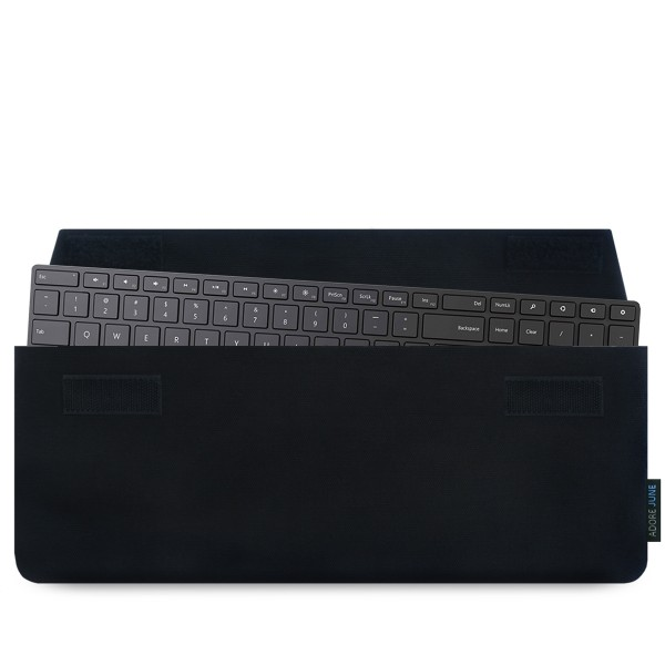 The picture shows the front of Keeb Sleeve for Microsoft Designer Bluetooth Desktop Keyboard in color Black; As an illustration, it also shows what the compatible device looks like in this bag